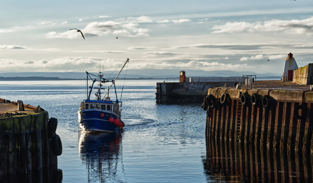 Fishing boat arriving at Burghead harbour